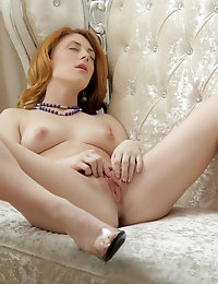 Alluring sex kitten shows her sweet shaved pussy