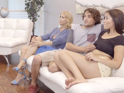 Karter Foxx is hanging out on the couch with her boyfriend Tyler Nixon and his stepmom Alexis Fawx. Tyler keeps trying to grab Karter's tits, but Alexis always seems to be watching. Eventually the two young lovers move to the kitchen, where Karter soon finds herself on her knees sucking Tyler off. Alexis wanders into the kitchen eventually and discovers the couple's naughty secret.Alexis tries to talk to the couple, but soon she realizes that she could teach them a thing or two. It's not long before she's instructing Karter on the proper way to give Tyler a blowjob. She rewards Karter for a job well done by feasting on the younger girl's greedy pussy, which kicks off a threesome this trio will never forget.After giving Karter all the tips she can for how to suck and fuck like a champ, Alexis can only demonstrate new positions for her two young disciples. She guides Tyler into giving them all the orgasms they can handle. Once he has finally satisfied his lusty ladies, they work their tongues and mouths to bring him off all over Karter's face so that she can snowball her boyfriend's cum with his stepmother.