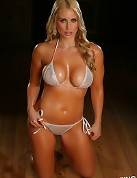 Busty blonde Alluring Vixen babe Deanna shows off her big boobs in her skimpy sexy silver string bikini