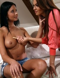 Tanned hoties lick each other out