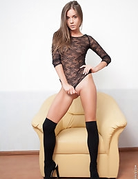 Gorgeous lady Guerlain in black stockings posing on the chair