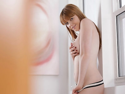 Buxom redhead Marie McCray slips off her panties to bring her moistening pussy to hip thrusting orgasm with her fingers