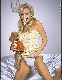 Cory in pigtails with her teddy bear may sound cute, but it's also sexy when the blond beauty strips down in bed. She doesn't look ready for sleep, but is primed for a little loving in Cory Bedtime with Teddy