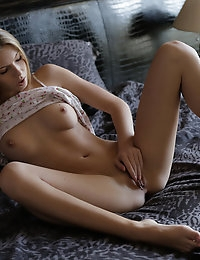 Lovely Ebbi is so hot from sexting that she needs to give her small tits a long massage and then fondle her bald pussy