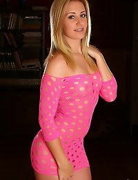Perky blonde babe Ashley Vallone teases in a slutty pink dress full of holes and nothing underneath