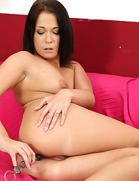 Gorgeous Angela rubs her fingers across her twat
