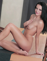 Hot babe Sapphira plays with her pussy on top of the dining table