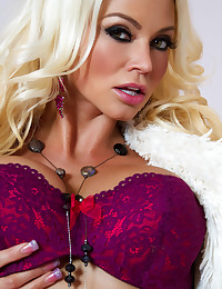 Beautiful blonde Nikita Von James shows off her enormous breasts.