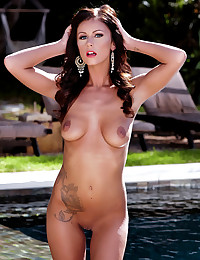 Whitney Westgate strips off beside the pool and masturbates