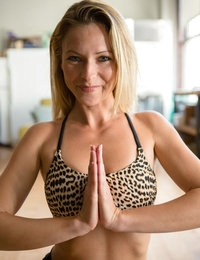 Watching a hot girl doing yoga is one thing, watching a goddess doing naked yoga is simply mind blowing. When Lena started her routine my anticipation grew with every pose and when she finally dropped her top my heart skipped a beat. Let's get sweaty!