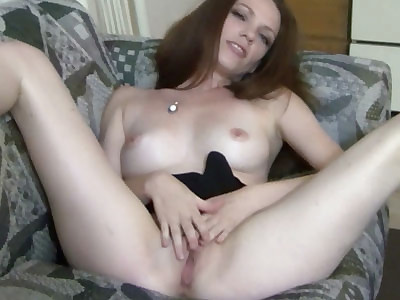 Horny redhead hottie Raine is finger banging her twat and making herself cum hard