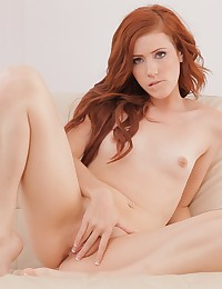 Playful redhead Elle Alexandra seduces herself in the sun and heads indoors for an intimate encounter with her pussy