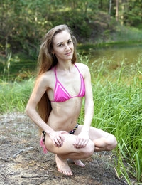 Skinny teen Larisa with shaved pussy stripping outdoors
