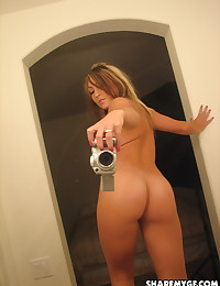Sexy busty girlfriend takes selfshot mirror pictures of her huge boobs and perfect ass for her boyfriend